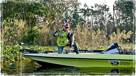 Scott Canterbury Holding Bass in a Boat