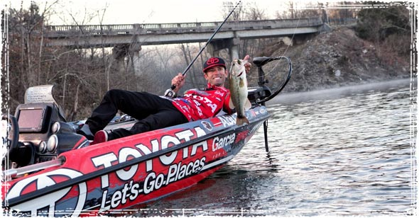 Pro Angler Mike Iaconelli Pulling a Bass out of the Water