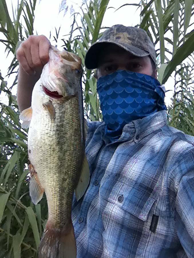 Holding a Largemouth Bass
