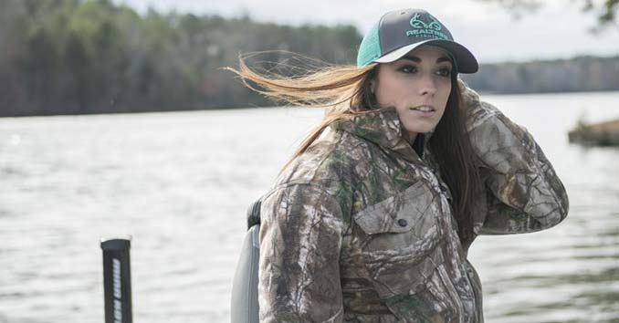 Woman wearing Realtree Gear and a Realtree Fishing Hat