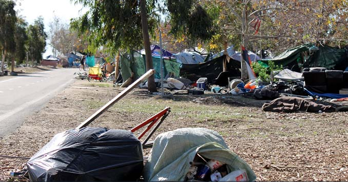homeless camp near river in California